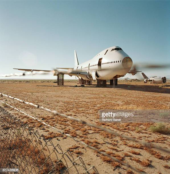 In midday heat of the arid Sonoran desert sit the remains of a Boeing 747 airliner at the storage facility at Mojave California Here the fate of the...