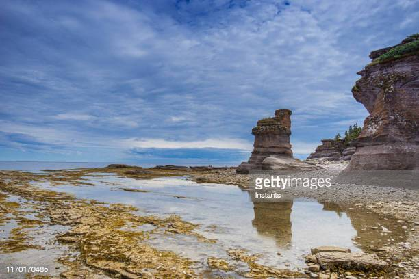 in mingan archipelago national park reserve, a view at the monoliths of quarry island. - river st lawrence stock pictures, royalty-free photos & images
