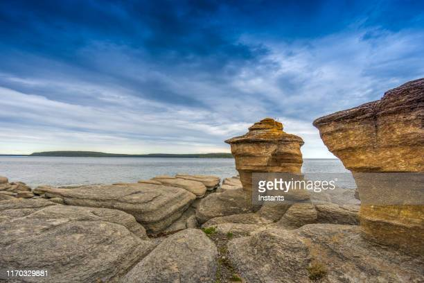 in mingan archipelago national park reserve, the beautiful scenery of niapiskau island with its monoliths dating back close to 500 million years. - river st lawrence stock pictures, royalty-free photos & images