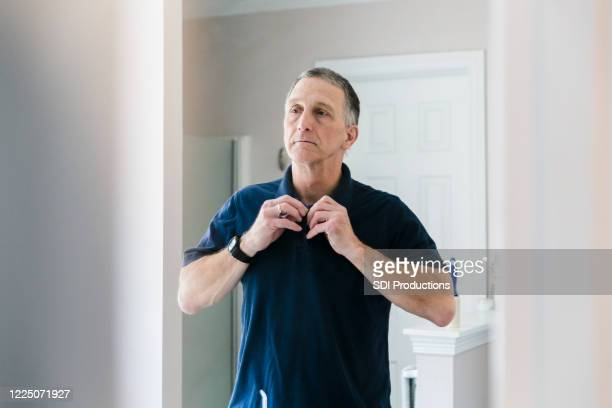in morning, mature man prepares for his work day - shirt stock pictures, royalty-free photos & images