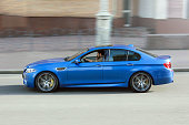 BMW M5 (F10) in motion at high speed