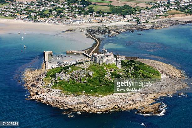 In Mount bay two miles east of Penzance is a Rocky island crowned by medieval church and castle called St Michael's Mount in this aerial photo taken...