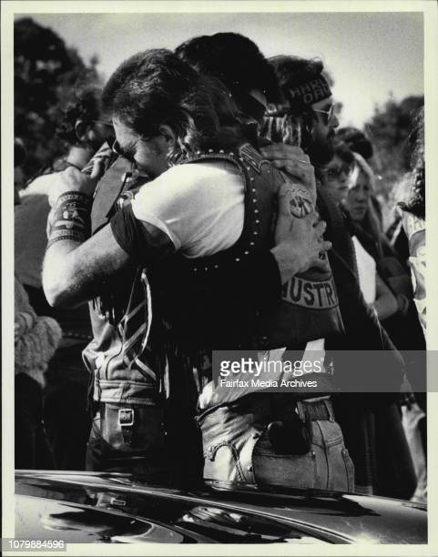 In Mourning Two members of the Bandido bikie gang comfort each other at the funeral at Rockwood Cemetry of victims of the Milperra massacre