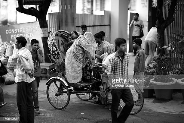 In my previous upload you will see the son hanging behind the rickshaw, here he watches helplessly as his sick mother is being helped by most...