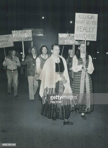 In native costumes Canadians of East European extraction march in protest near Parliament Buildings where Soviet Premier Alexei Kosygin was at state...
