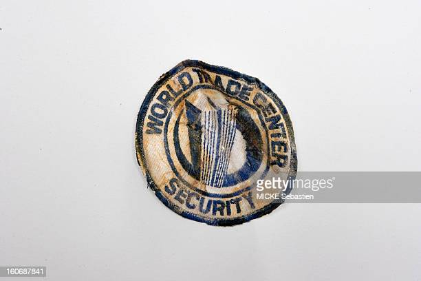 In New York three museums have opened or are exposed objects recovered from the ruins of the World Trade Center badge of a member of the security of...