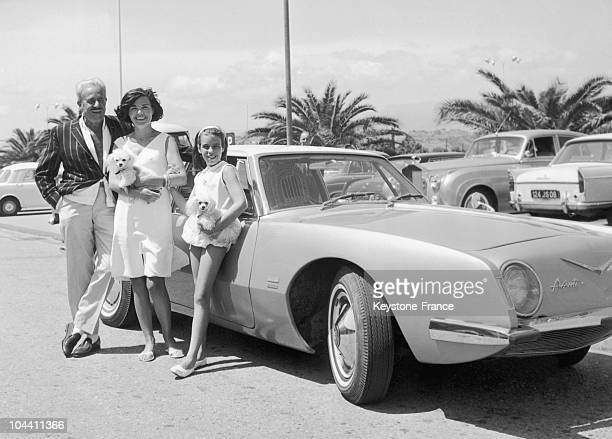 In Nice on August 8 the aesthetic industrialist Raymond LOEWY his wife and their daughter posed before the 1953 STUDEBAKER Starliner Avanti drawn by...