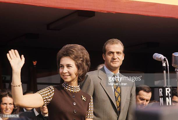 In November 1971 Princess Sophia and Prince Juan Carlos of Spain visit the city of Burgos in Castile and Leon Here waving to the crowd with a wave of...