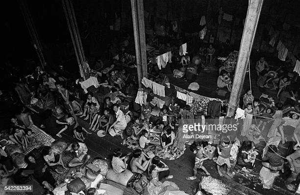 """In November 1978, the Malaysian government refused to allow the Hai Hong, an old freighter packed with 2,500 refugees, to land. The """"boat people"""",..."""