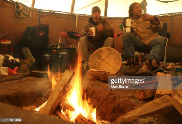 In Oceti Sakowin camp tepee run by Matthew Black Eagle Man , there is discussion around a hot, smokey fire about the news that the U.S. Army Corps Of...