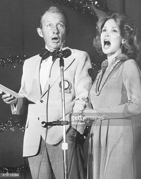 In one of his rare public appearances singer Bing Crosby accompanied by his wife Kathy entertains some old people at San Francisco's Laguna Honda...