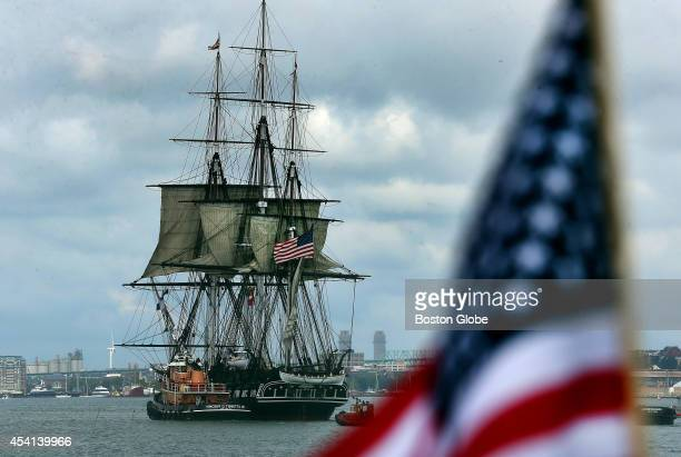 In one of it's final turnarounds the USS Constitution fires it's guns to salute the crowds at Castle Island The last two turnarounds are August 29...