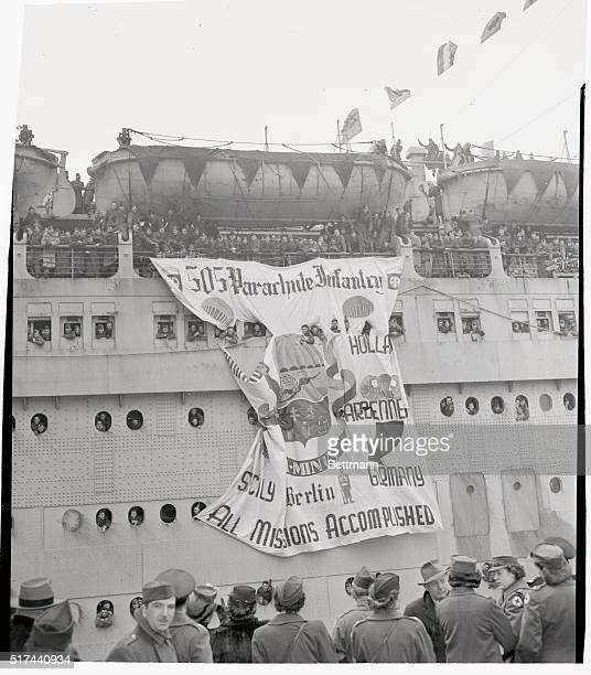 In one of the most colorful welcomes since the end of the war 800 troops of the 82nd Airborne Division were greeted at New York as they arrived...