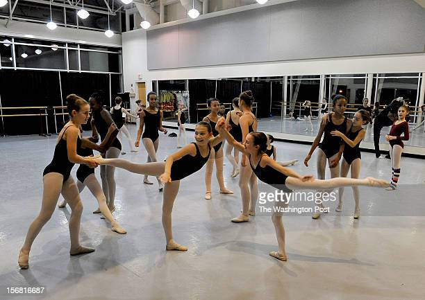 In one of the spacious dance practice rooms young women warm up before the rehearsal for the Nutcracker ballet The ARC Theater in SE Washington has...