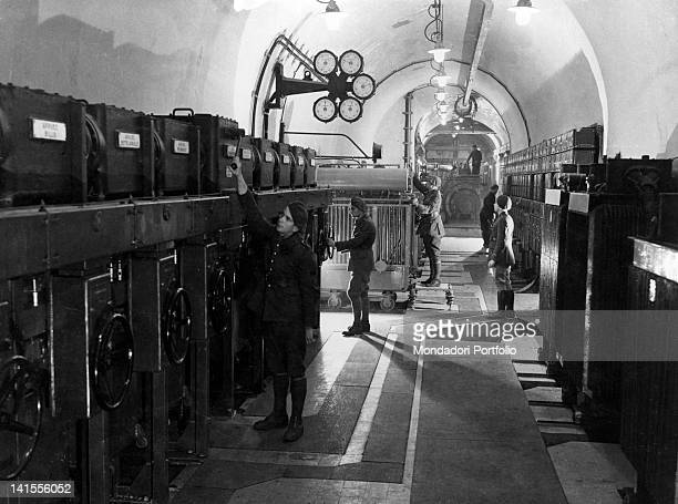 In one of the tunnels of Maginot Line French soldiers checking equipment and electrical controls France 1939