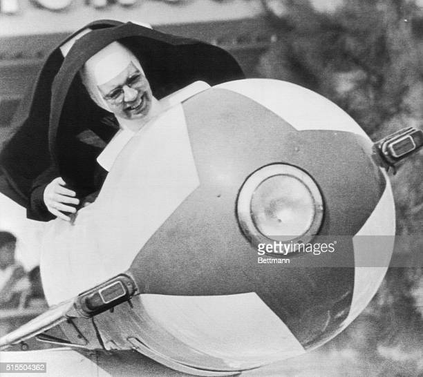In orbit are Sister Euphemia and her copilot Sister Michael James as they ride the 'Tomorrowland' rocket at Disneyland Catholic schools were out on a...