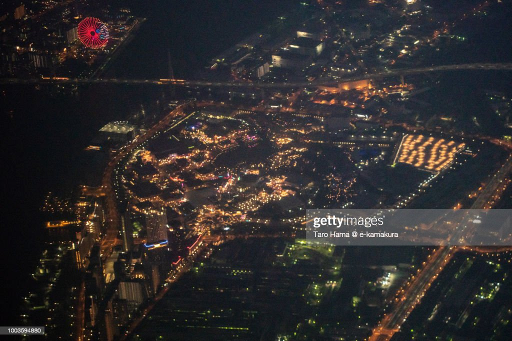 USJ (Universal Studios Japan) in Osaka night time aerial view from airplane : Stock Photo
