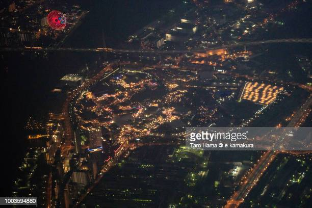 USJ (Universal Studios Japan) in Osaka night time aerial view from airplane