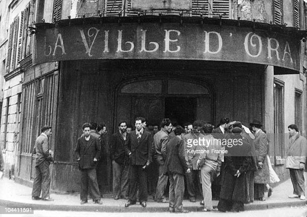 In Paris in April 1950 North African immigrants talk in front of a hotel named LA VILLE D'ORAN where furnished rooms are rented out to immigrants who...