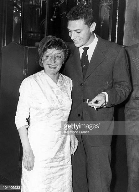 In Paris the couple singer Edith PIAF and young singersongwriter Georges MOUSTAKI wave their goodbyes to the press before departing for a series of...
