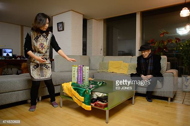 In photo taken on February 22 2014 Kim SeRin sits after arriving at his home in Seoul after returning from a family reunion with his North Korean...