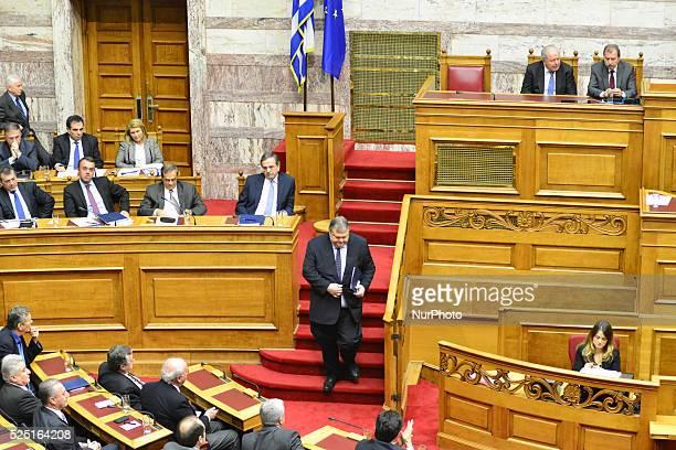 Evangelos Venizelos passes Prime Minister Antonis Samaras Debate and vote in the Greek parliament over the 2015 budget The Greek Parliament on...