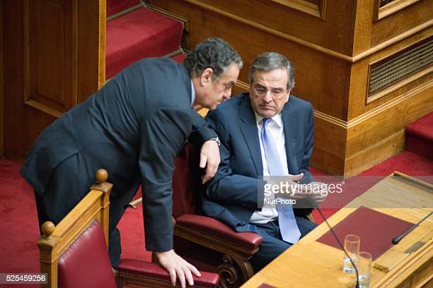 PM Antonis Samaras discussing with Charalambos Athanasiou Minster of Justice Debate and vote in the Greek parliament over the 2015 budget The Greek...