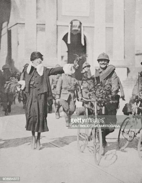 In Porta del Popolo a lady offers a flower to a soldier returning in Rome Italy from the front after the end of the First World War from the magazine...