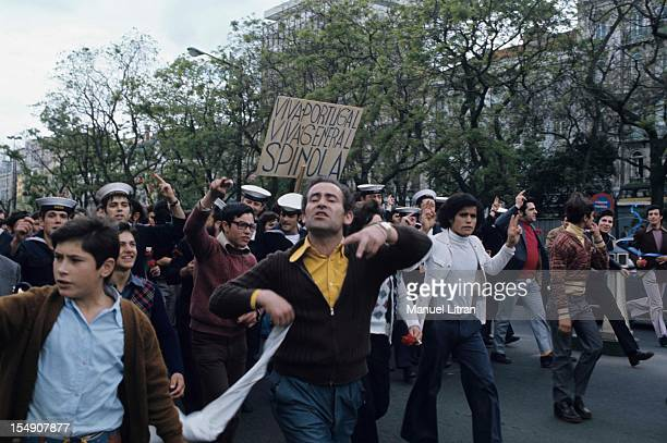 In Portugal on May 1 1974 A few days after the coup of General Antonio de Spinola thousands of Portuguese demonstrate in the streets a red carnation...