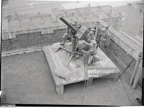 In preparation for air raids that may never come anti aircraft gun defenses were set up all over New York City as shown and crews were on 24 hour...