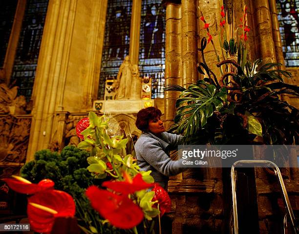 In preparation for the Commonwealth Observance Service in Westminster Abbey Jane Melville works on the floral arrangement which represents Malawi on...