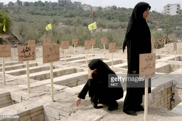 In Qana Lebanon a town that has become synonymous with massacre in the minds of many Lebanese families bury their dead Friday August 18 2006