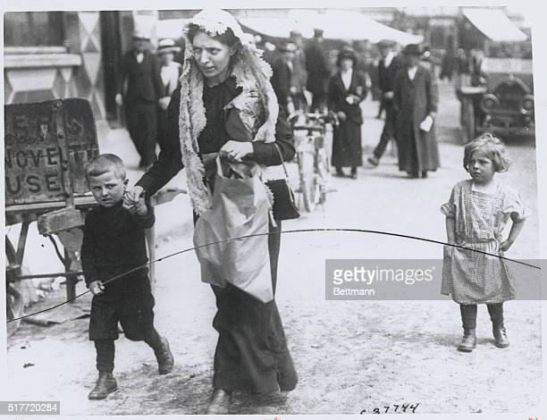 In Queenstown a family of survivors of the sinking of the British liner SS Lusitania make their way through the streets | Location Queenstown CoCork...
