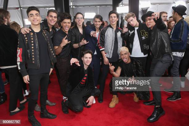 In Real Life and CNCO pose in the press room during the 2018 iHeartRadio Music Awards which broadcasted live on TBS TNT and truTV at The Forum on...