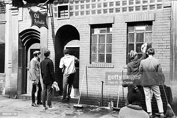In response to a sanitation workers strike residents of Manhattan's East Village take up brooms mops and soap to clean Third Street in a 'SweepIn'...