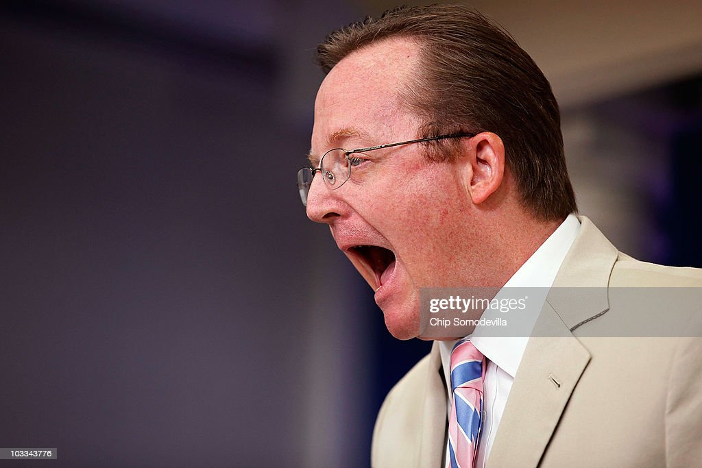 In response to the question 'Did you put your foot in your mouth?' White House Press Secretary Robert Gibbs opens up to show that his mouth is empty during the daily press briefing in the Brady Press Briefing Room at the White House August 11, 2010 in Washington, DC. Gibbs criticized what he called the 'professional left' for comparing President Barack Obama to former President George Bush and faulting Obama for his willingness to compromise with conservatives.