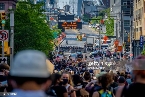 In riot geat blocking protesters from entering the Manhattan Bridge. Protesters by the thousands converged at Grand Army Plaza in Brooklyn marching...