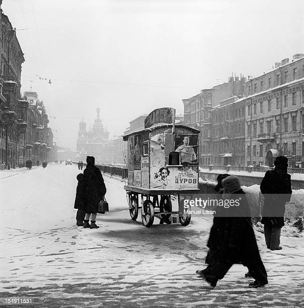 In Russia in Leningrad in March 1956 while reporting on the State Hermitage Museum Passers bundled in coats fur hats caps crowd into a snowy street...