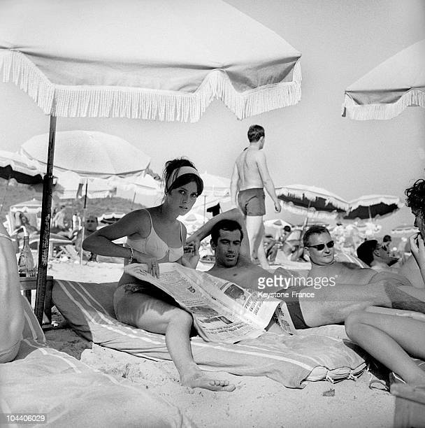 In Saint-Tropez , the film director Roger VADIM and his recent conquest, Catherine DENEUVE, then a young actress just starting out, resting under a...