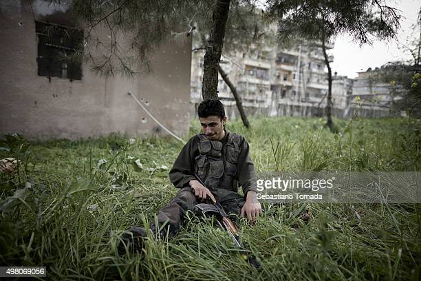In Salahadeen one of Aleppo's front lines a Free Syrian Army fighter mourns the death of a comrade March 20 2013