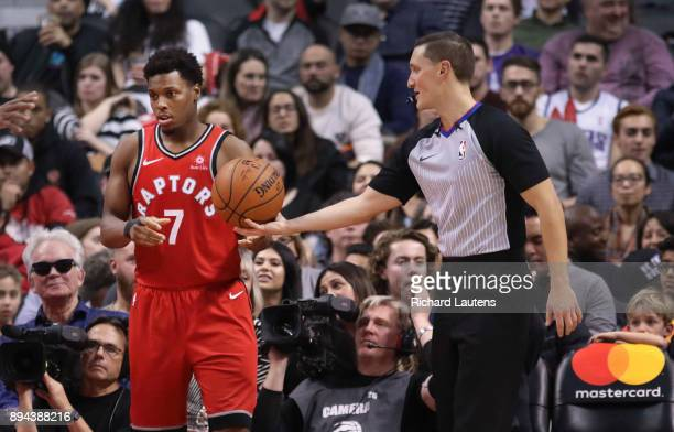 TORONTO ON DECEMBER 17 In second half action referee JB DeRosa hands the ball on the sidelines to Toronto Raptors guard Kyle Lowry DeRosa threw Lowry...