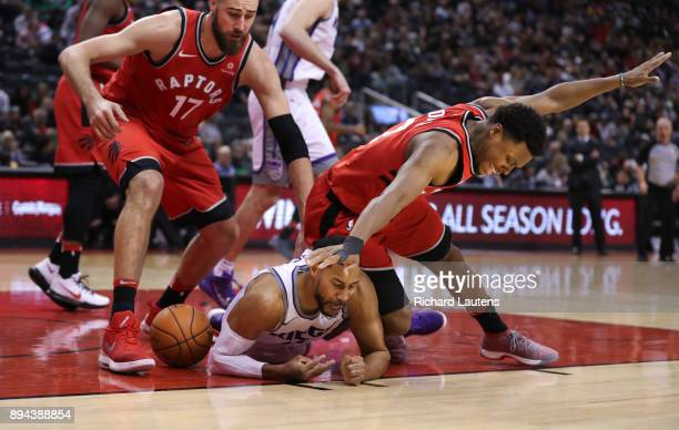 TORONTO ON DECEMBER 17 In second half action Sacramento Kings guard Garrett Temple gets the worst of the scramble for the ball with Toronto Raptors...