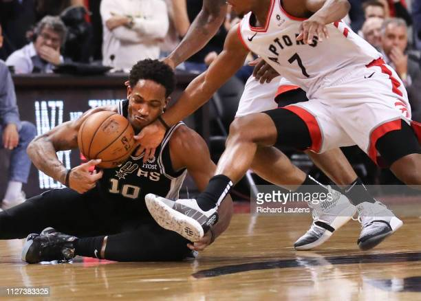 February 22: In second half action, San Antonio Spurs guard DeMar DeRozan goes down courtesy of Toronto Raptors guard Kyle Lowry and Toronto Raptors...