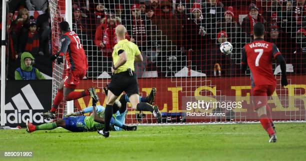 TORONTO ON DECEMBER 9 In second half action Toronto FC forward Jozy Altidore leaps over the goaltender as he watches his game winning goal head...