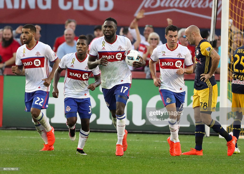 TORONTO, ON - SEPTEMBER, 18 In second half action, Toronto FC forward Jozy Altidore (17) runs back with the ball he scored to tie the game. The Toronto Football Club (TFC) tied the New York Red Bulls 3-3 in MLS action at BMO Field in Toronto. The tie secured a playoff spot for the TFC. September 18, 2016