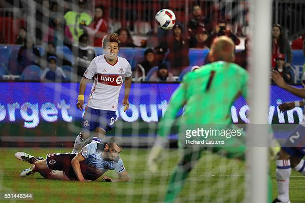 TORONTO ON MAY 14 In second half action Toronto FC forward Tsubasa Endoh makes another late game shot on Vancouver Whitecaps goalkeeper David Ousted...