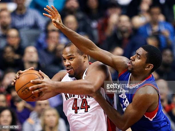 In second half action Toronto Raptors center Chuck Hayes faces a big arm from Philadelphia 76ers guard Hollis Thompson The Toronto Raptors beat the...