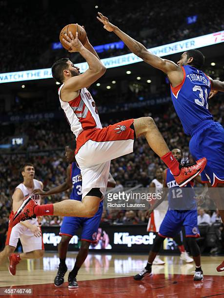 In second half action Toronto Raptors guard Greivis Vasquez runs his way up for a shot as Philadelphia 76ers guard Hollis Thompson plays defence The...