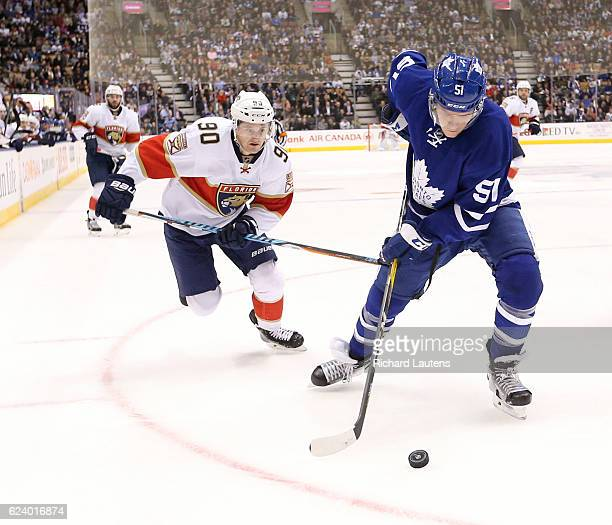 TORONTO ON NOVEMBER 17 In second period action Toronto Maple Leafs defenseman Jake Gardiner stick handles in his own end as Florida Panthers center...