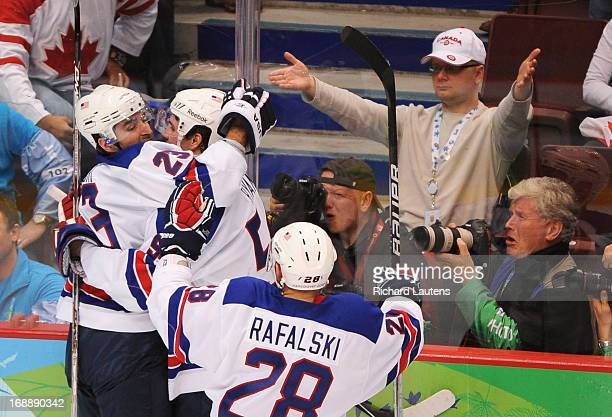In second period action USA's Chris Drury celebrates his goalwith USA's Bobby Ryan as USA's Brian Rafalski comes in Canada took on the USA in Men's...